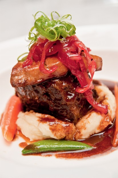 Red Wine Braised Ribeye on truffle scented mash, topped with seared foie gras, grenadine onion marmalade and merlot glace